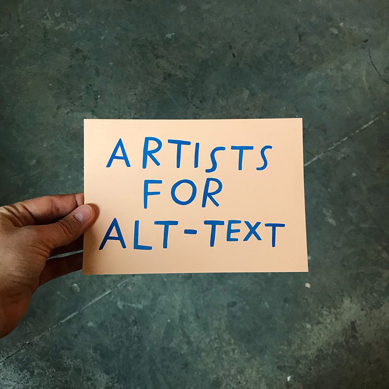 hand holding a card that reads ARTISTS FOR ALT-TEXT in a handmade blue typeface, all with a greenish marble background
